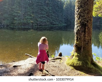 Young girl first try at photography at the lake in Fort Abercrombie State Park