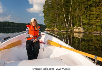 Young girl fishing from boat