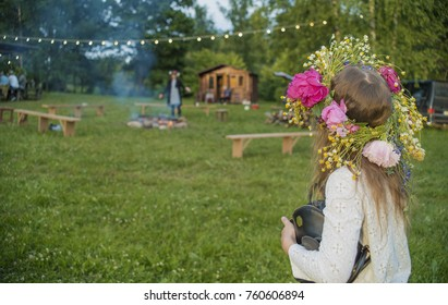 Young girl with flower crown, midsummer, Latvia