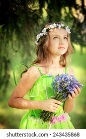 Young girl with flowers in the  forest