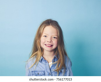 young girl in front of blue background