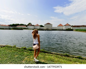 Young girl in front of Nymphenburg Palace in Munich, Bavaria, Germany. July 2019