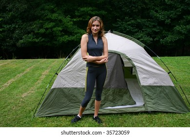 young girl in front of a tent at a campsite