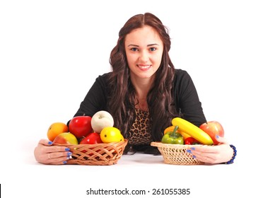 Young girl with a fruit basket isolated on white