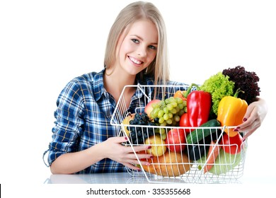 Young girl with full food basket isolated on white background