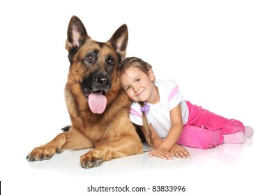 Young girl and German shepherd dog on white background