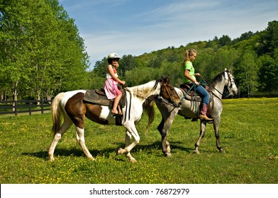 A young girl getting a horseback riding lesson.