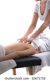 Young girl getting massage from a therapist