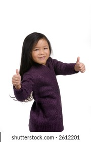 A young girl gives the two thumbs up approval.