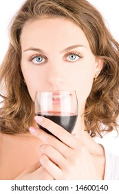 Young girl with a glass of red wine, isolated on white background