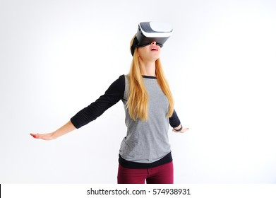 Young girl with glasses of virtual reality on a white background