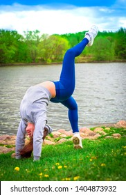 young girl goes in for sports in nature. healthy lifestyle.flaxible child doing joga poses bridge streching in the nature