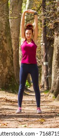 Young girl, good looks, after running for exercise stretching the body, healthy life, training, muscles