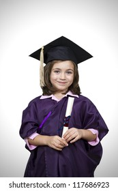 Young girl in graduation dress  with diploma over white background