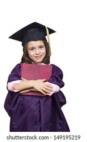 Young girl in graduation dress.Attractive kid in oversized large graduation cap and gown with diploma over white background