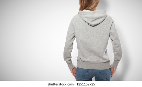 young girl in gray sweatshirt, gray hoodies back view isolated on white background. mock up