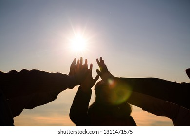 Young girl group are join hands for working the job success , Hands, symbolizing the hands to unity and teamwork ,success ,helps.