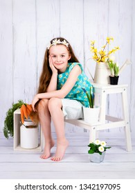 Young girl growing flowers in the spring