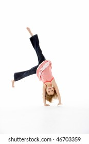 Young Girl In Gymnastic Pose Doing Cartwheel