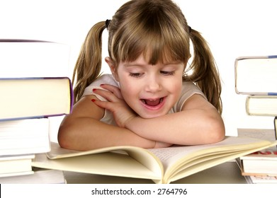 A young girl happy about reading a book