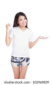 Young Girl happy smile show white T-Shirt with hand introduce something isolated on white background (designer could add any thing on empty copy space), model is a asian woman