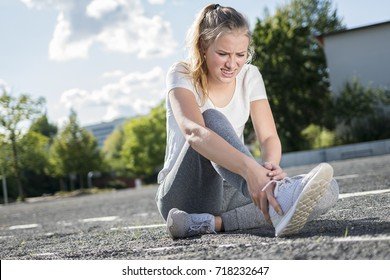 Young girl has pain in his foot