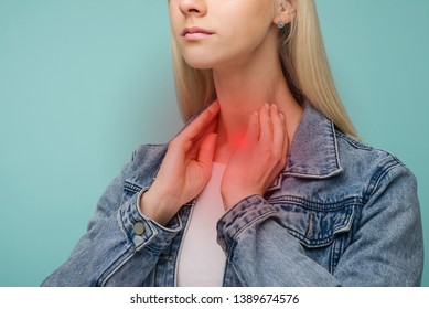 A young girl has a sore throat. Thyroid problems - Image