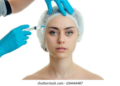 a young girl with a hat on his head and she looks directly make facial filler injections isolated on a white background
