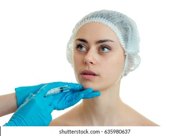 a young girl in a hat which do medical facial injections is isolated on a white background