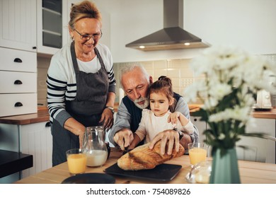 Young girl having breakfast with her grandparents
