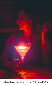 young girl having cocktail in nightclub