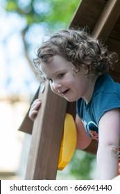 Young girl having fun on a swing set