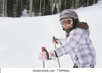 Young Girl having fun skiing at a ski resort