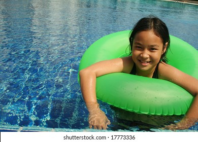 Young girl having good time in the pool.