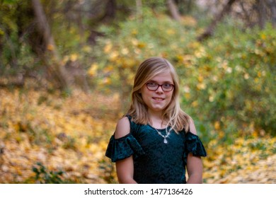 young girl having her portrait taking while on a walk in the woods
