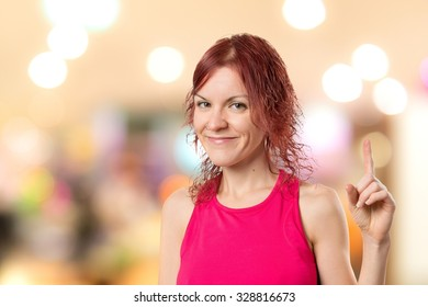 Young girl having an idea on unfocused background
