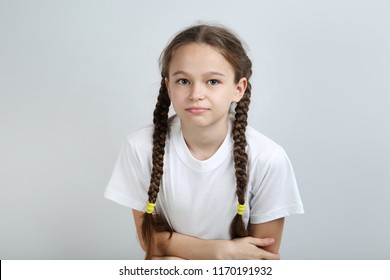 Young girl having stomach ache on grey background