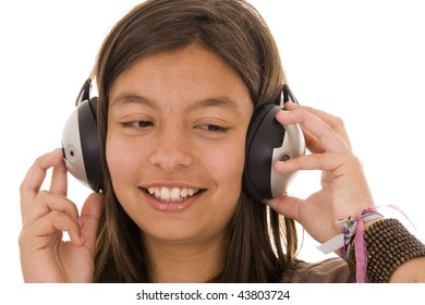 Young girl with headphones listening music