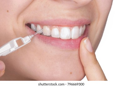 Young girl with a healthy smile using a dental brush