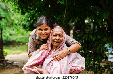 A young girl helping an old Lady.