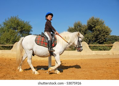 young girl and her best friend white shetland pony