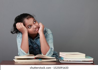Young girl with her books in the study room