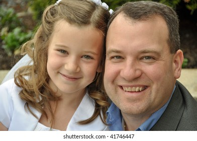 a young girl and her father on first communion day