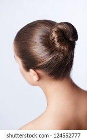 Young girl with her hair in a bun