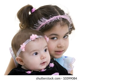 A young girl with her little sister smiling. Bonding, Love, childhood