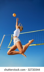 The young girl in high flying with a ball