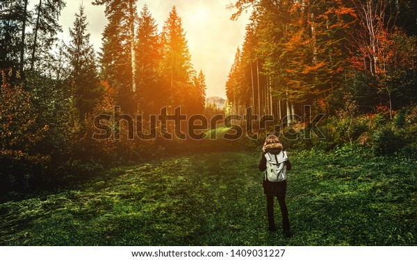 Young girl hiker at forest mountains landscape with backpack travel. Lifestyle wanderlust adventure. Location Carpathian national park, Ukraine, Europe