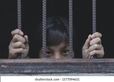 young girl hold cage with eye sad and hopeless, Human trafficking concept, human rights violations, Stop violence and abused children. traumatized children concept.