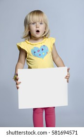 Young girl holding a blank sign.