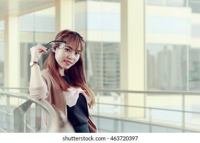 Young girl holding eyeglasses, women lifestyle